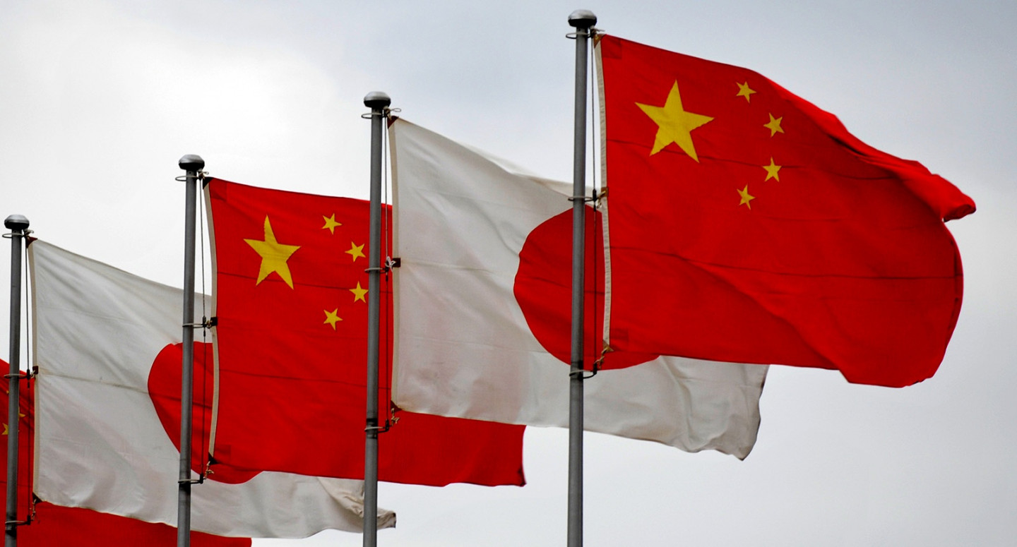 National flags of Japan and China (R) ar